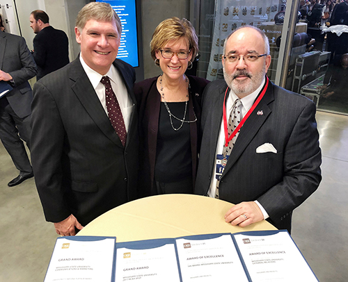 Shown receiving the awards for OPA were MSU's Checky Herrington, OPA creative director and marketing research analyst; Harriet V. Laird, OPA associate director; and Sid Salter, OPA director and MSU's chief communications officer